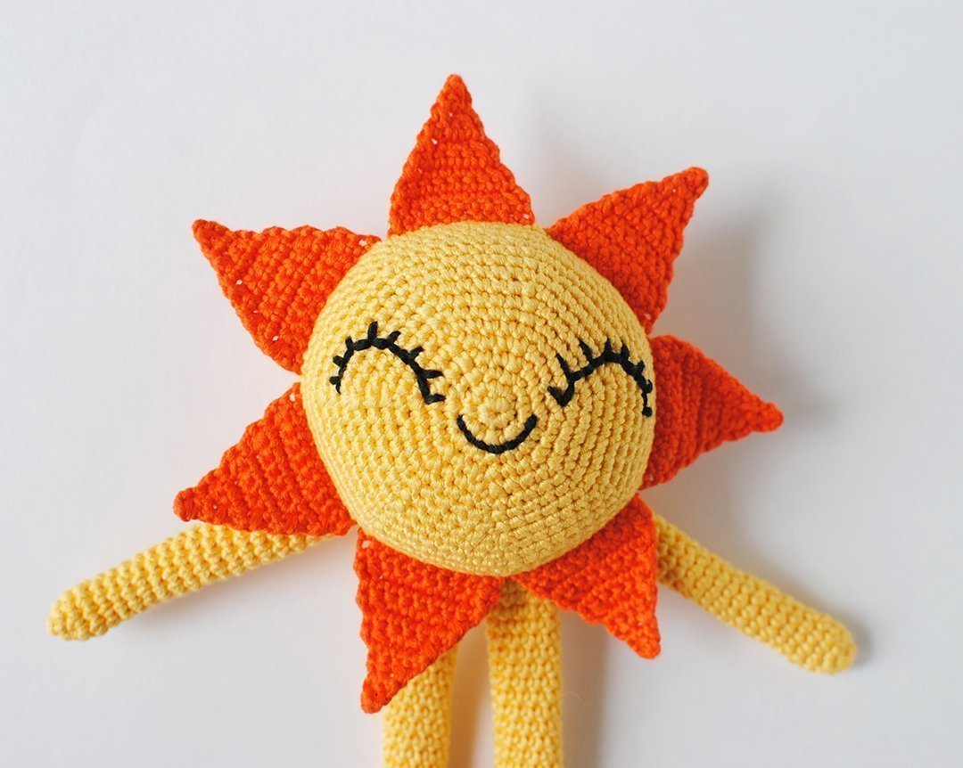 Amigurumi Sun shot up close to show face embroidery.
