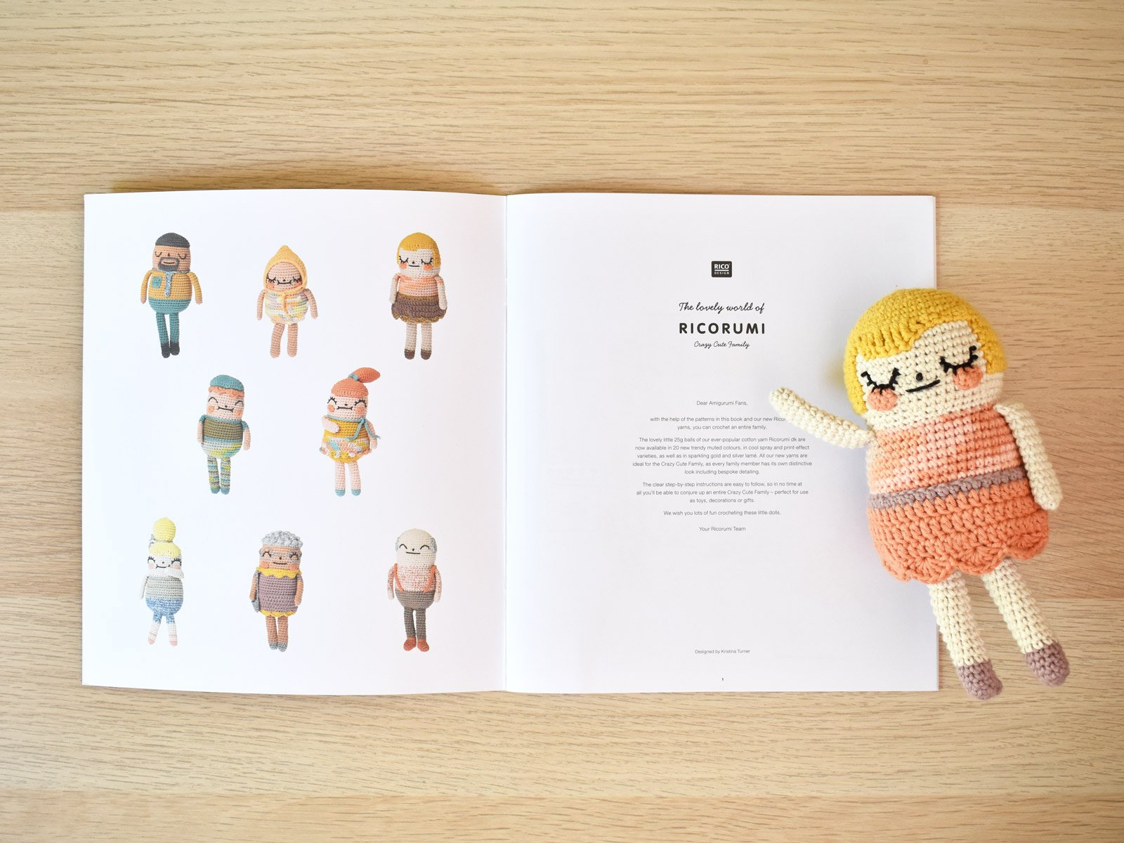 Crochet mom amigurumi doll lays on top of the pattern booklet on the first page.