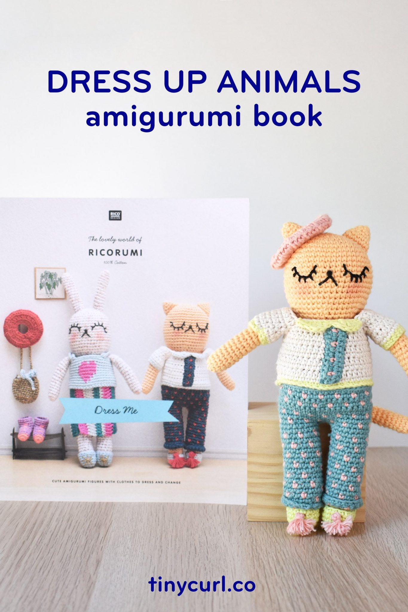"Ricorumi Dress Me amigurumi book standing up behind a crochet cat in an outfit. The text on the image says ""Dress Up Animals amigurumi book"""