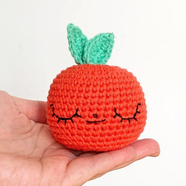 crochet apple in a hand