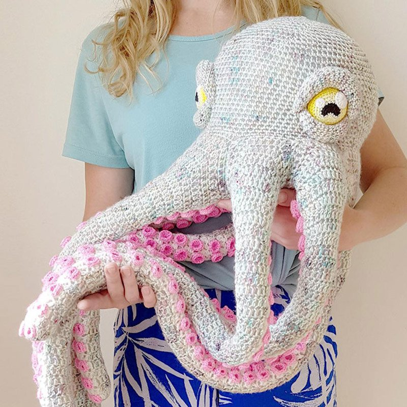 crochet octopus in someone's arms