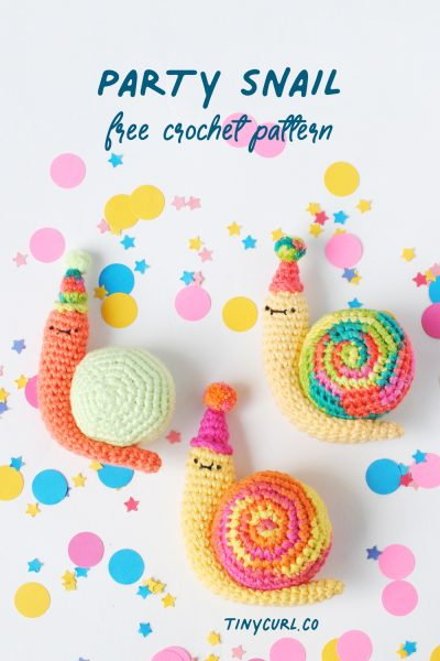 Crochet snails on a confetti background.