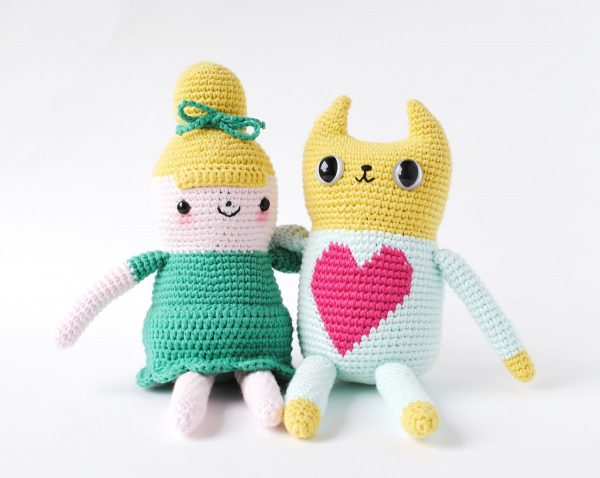 a crochet doll and crochet cat with safety eyes