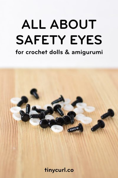 "A picture of safety eyes on a wooden backdrop. The text says ""All about safety eyes for crochet dolls and amigurumi"""