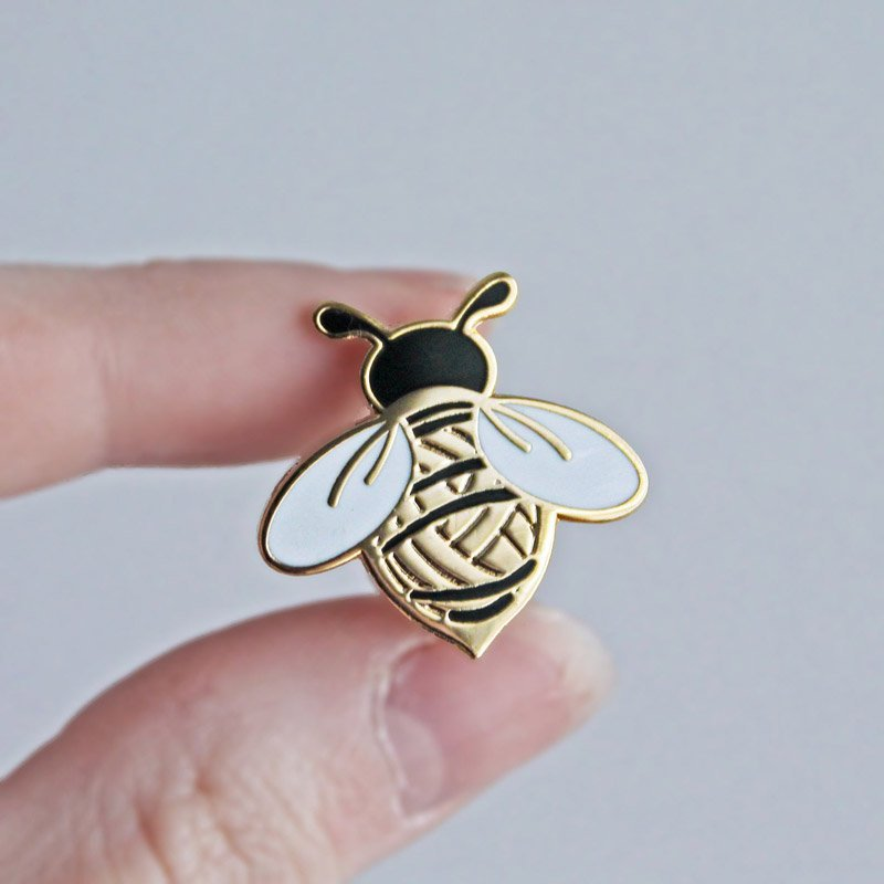 bee with yarn ball enamel pin