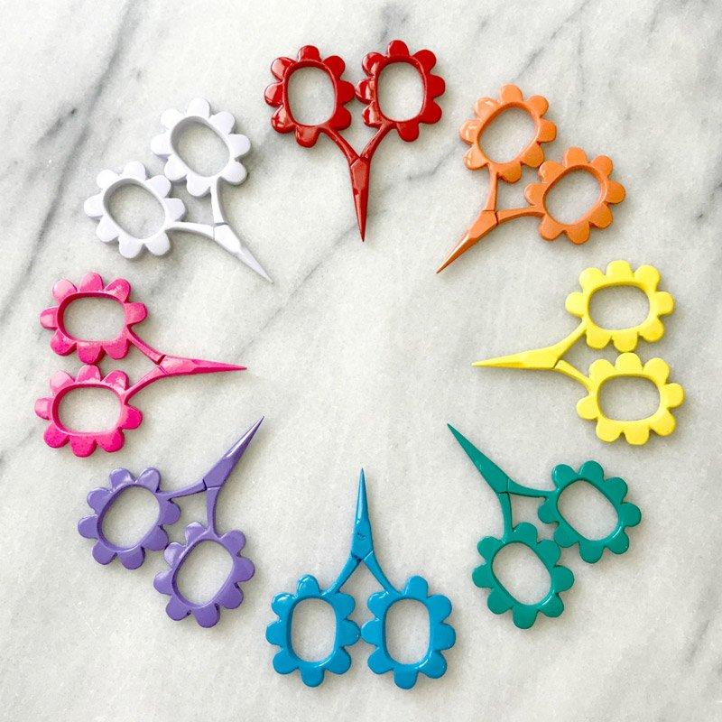 a rainbow of small daisy scissors