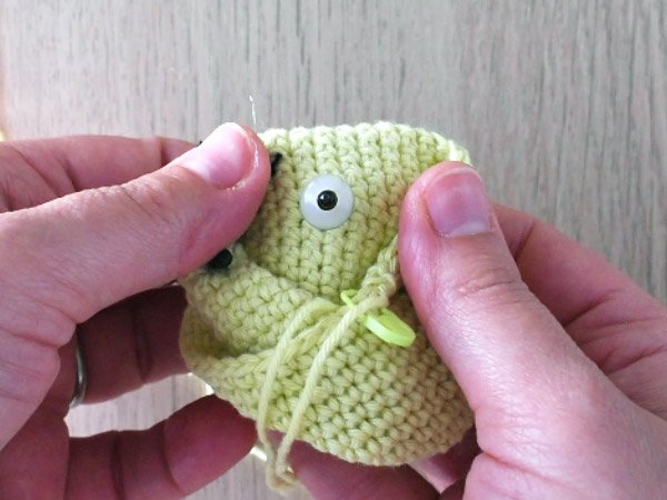 Back washer of safety eye on crochet doll.