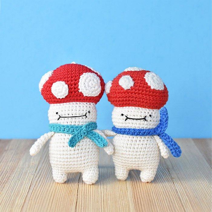 Two mushroom crochet dolls