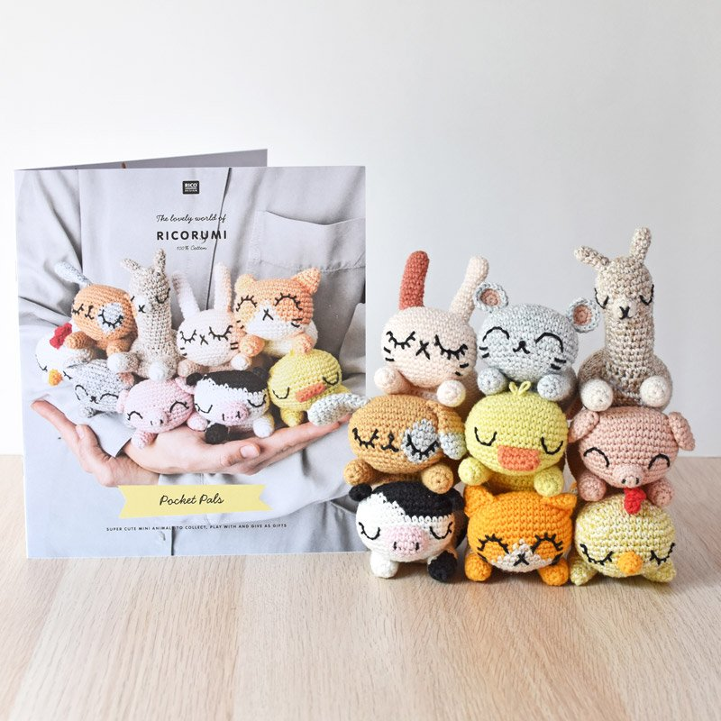 ricorumi pocket pals with amigurumi animals next to it