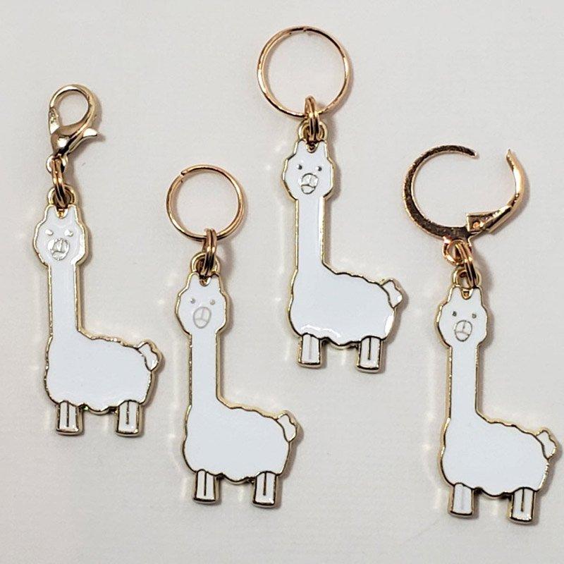 four alpaca stitch markers
