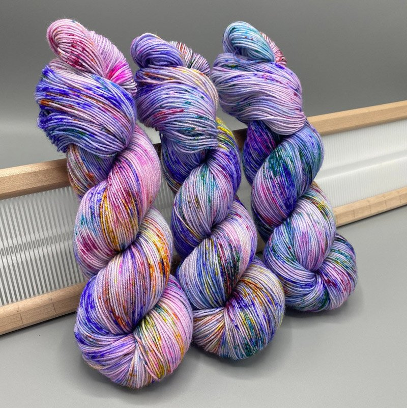 3 hanks of purple hand-dyed yarn