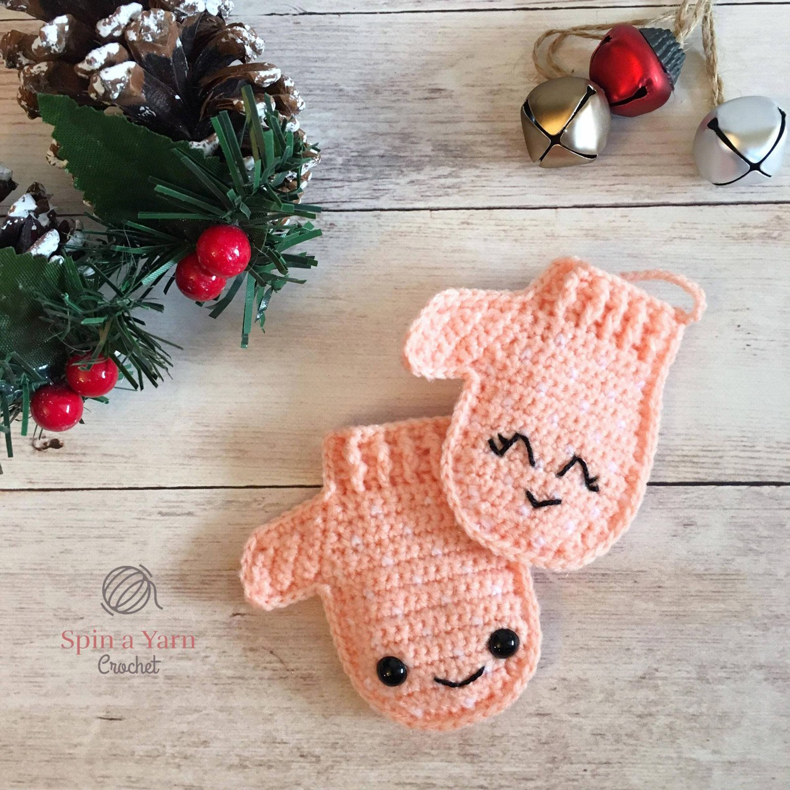 a pair of crochet mittens on a wooden backdrop