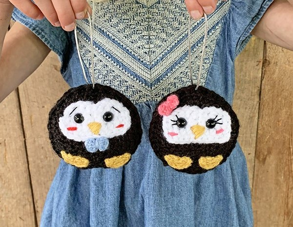 two penguin crochet ornaments