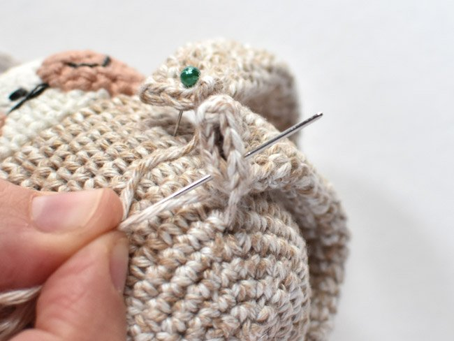 attaching the leg loop to the crochet sloth