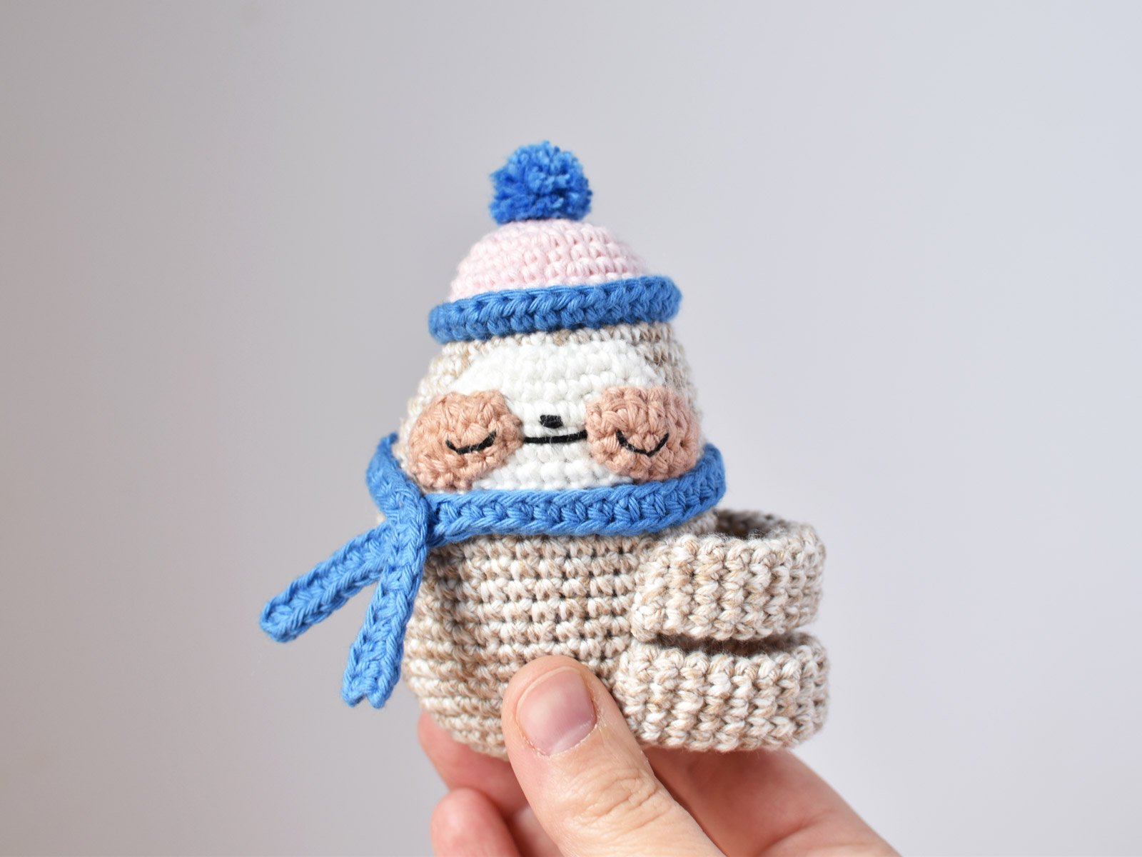 Crochet sloth with hat and scarf