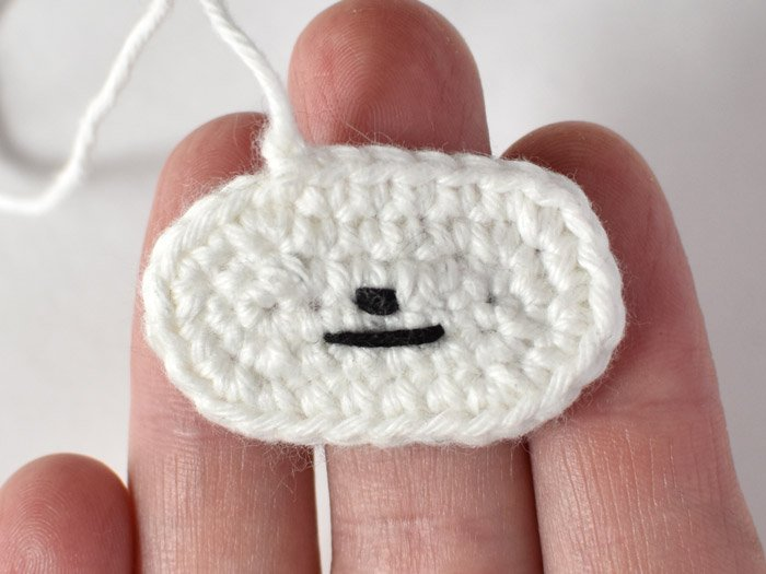 sloth amigurumi face embroidery in hand
