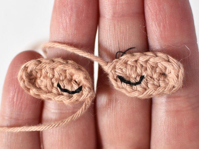 sloth amigurumi eye embroidery in hand